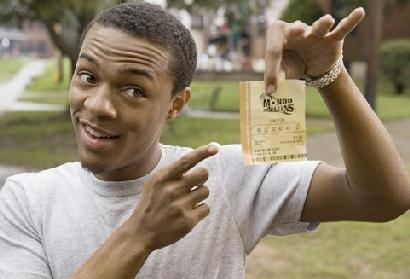 Kevin Carson (Bow Wow) shows off his winning lottery ticket