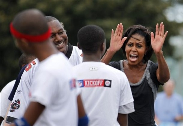 FLOTUS high five Michelle Obama Plays Flag Football