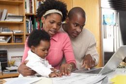 black family at laptop