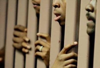 black men in jail - prison - behind bars