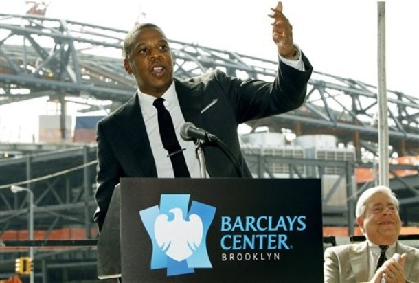 Nets part-owner and hip-hop mogul Jay-Z gestures during a news conference in front of the Barclays Center, under construction in background, as Brooklyn borough President Marty Markowitz, right, looks on Monday, Sept. 26, 2011 in Brooklyn, N.Y.