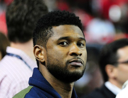 Usher watches warmups before the game between the Atlanta Falcons and the Philadelphia Eagles at the Georgia Dome on Sept. 18, 2011 in Atlanta