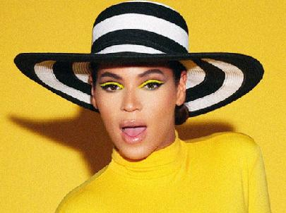 beyonce(2011-b&w-ringed-hat-yellow-bgrd-med-wide)
