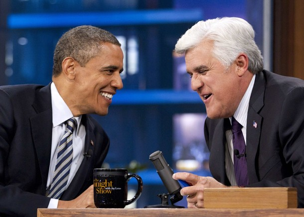 President Barack Obama smiles during taping of the Tonight Show with Jay Leno Show in Burbank, California October 25, 2011.
