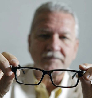 Richard Mark of PixelOptics holds a pair of the company's electronic glasses