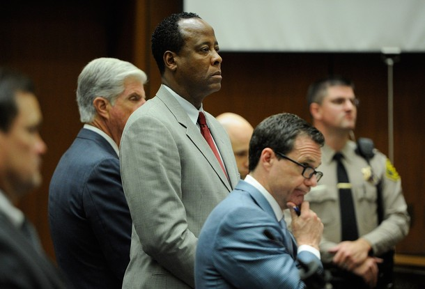 Dr. Conrad Murray stands with defense attorney J. Michael Flanagan (2nd from L) and defense attorney Ed Chernoff (2nd from R) prior to the start of morning's court proceedings during the final stage of Conrad Murray's defense in his involuntary manslaughter trial in the death of singer Michael Jackson at the Los Angeles Superior Court on November 3, 2011 in Los Angeles
