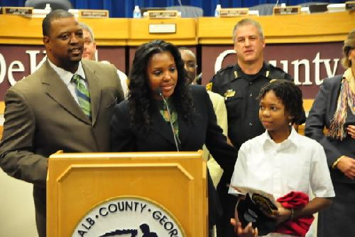 Justice Pate, 12, looks on with parents as he accepts awards, medals and certificates from Dekalb County, Georgia, for his heroic act of saving a 7-year old boy drowning in a hotel pool in Georgia.