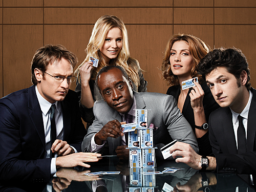 "Josh Lawson as Doug, Kristen Bell as Jeannie Van Der Hooven, Don Cheadle as Marty Kaan, Dawn Olivieri as Monica, and Ben Schwartz as Clyde Oberholt in ""House of Lies"""
