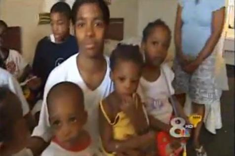 Angel Adams with her many children in a hotel room after being evicted from their apartment.
