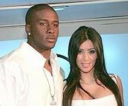reggie_bush&kim_kardashian(2011-white-med-big-ver-upper)