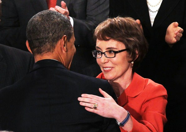 President Barack Obama hugs U.S. Rep. Gabrielle Giffords (D-AZ) before delivering his State of the Union address on January 24, 2012 in Washington, DC.