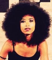 esperanza_spalding(2012-sitting-on-radio-big-ver-upper)
