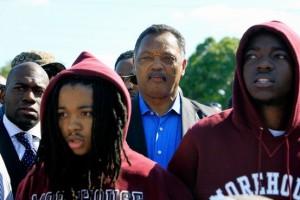 jesse jackson and protestors in hoodies