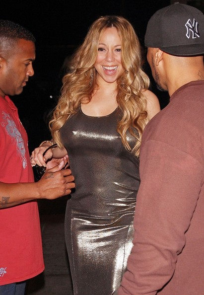 Singer Mariah Carey seen carrying a toy sheep and greeting waiting fans while leaving the Dorchester Hotel in London. (June 25, 2012)