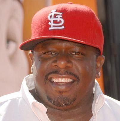 cedric_the_entertainer(2012-red-cap-big-ver-upper)