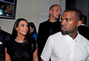 Kanye West and Kim Kardashian attend the Valentino Fashion Show during Paris Fashion Week. (July 5, 2012)