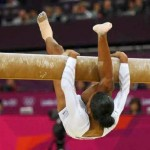 Gabby Ends Olympic Debut on Sour Note: Falters on Balance Beam