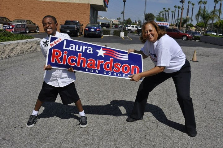 "He's too young to vote, but 8-year-old Buritius ""B.J."" Brannon says that he's supporting Congresswoman Laura Richardson for re-election. ---Photo by KBGraphflixx"