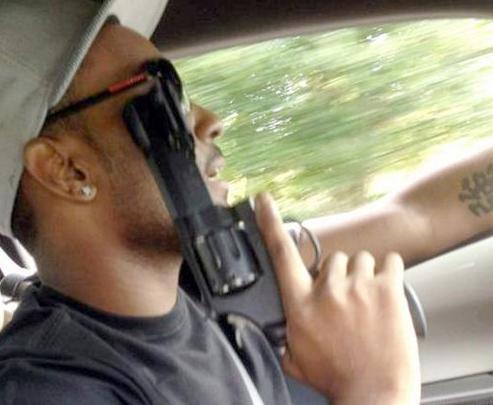 nick gordon (with gun)