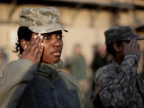black female soldier saluting