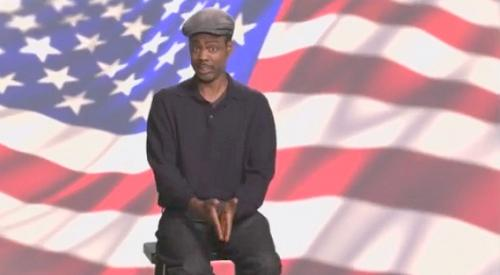 chris rock (in front of flag)
