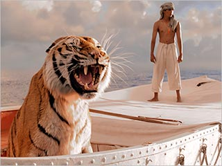 Suraj Sharma stars as Pi in the 20th Century Fox presentation of Life of Pi, scene here with a Bengal tiger names Richard Parker.