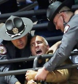 Protester at Obama campaign in Cincinnati rally hauled away by police.