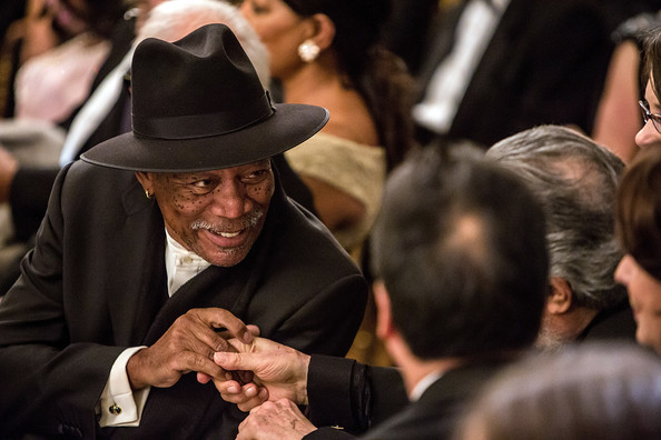 Actor Morgan Freeman greets another guest at the Kennedy Center Honors reception at the White House on December 2, 2012 in Washington, DC.