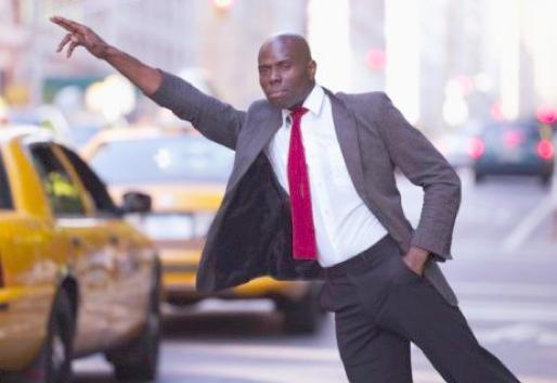 black man hailing taxicab