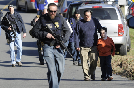 newtown school shooting (policemen with weapons & parent with child)