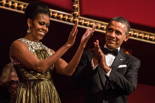 U.S. President Barack Obama and first lady Michelle Obama (C) attend the Kennedy Center Honors at the Kennedy Center on December 2, 2012 in Washington, DC.