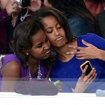 Sasha Obama Tries to Take Pic of her Parents Kissing (Watch)