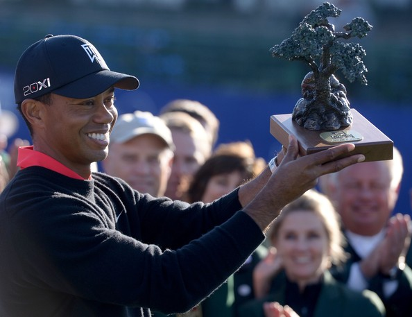 Tiger Woods holds the winner's trophy after his -14 under victory during the Final Round at the Farmers Insurance Open at Torrey Pines Golf Course on January 28, 2013 in La Jolla, California