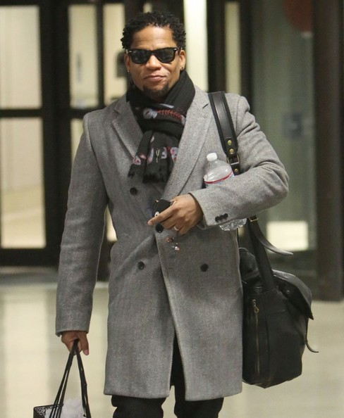 Actor/Comedian D.L. Hughley arriving on a flight at LAX airport in Los Angeles, California on January 2, 2013
