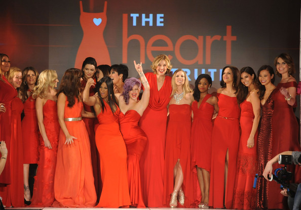 (L-R) Wendy Williams, Cindy Parsons, Nastia Liukin, Minka Kelly, Kendall Jenner, Kylie Jenner, Toni Braxton, Kelly Osbourne, Brenda Strong, Torah Bright, Gabrielle Douglas, Soledad O'brien, Roselyn Sanchez, Jamie Chung and Savannah Guthrie on the runway during The Heart Truth 2013 Fashion Show held at the Hammerstein Ballroom on February 6, 2013 in New York City.
