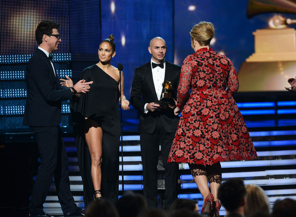 "Singers Jennifer Lopez, Pitbull present Adele the Best Pop Solo Performance for ""Set Fire to the Rain (Live)"" onstage at the 55th Annual GRAMMY Awards at Staples Center on February 10, 2013 in Los Angeles"