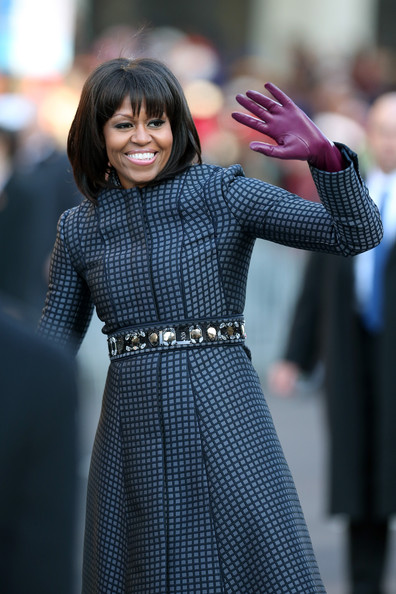 First lady Michelle Obama waves as the presidential inaugural parade winds through the nation's capital January 21, 2013 in Washington, DC. Barack Obama was re-elected for a second term as President of the United States
