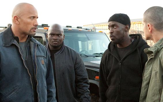 Dwayne Johnson, left, with Shun Hagins, Michael Kenneth Williams and Jaime Medeles, stars as a civilian who gets mixed up with the feds and Mexican drug cartels