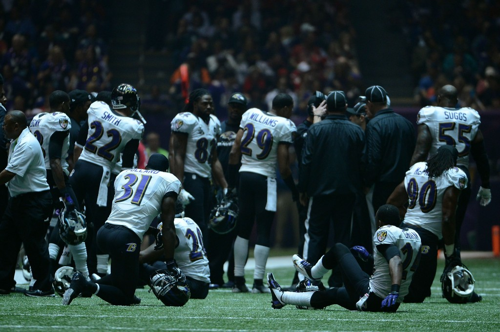 The Ravens wait out a power outage during Super Bowl XLVII at the Mercedes-Benz Superdome on February 3, 2013 in New Orleans, Louisiana.