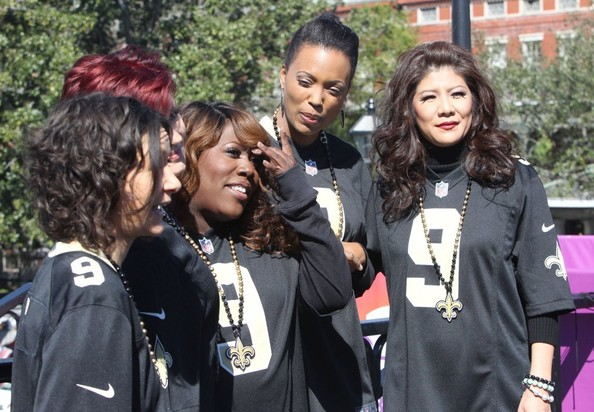"""The Talk"" hosts Sara Gilbert, Sharon Osbourne, Sheryl Underwood, Aisha Tyler and Julie Chen wear New Orlean Saints jerseys while filming their talk show outside the Superdome on February 1, 2013 in New Orleans"