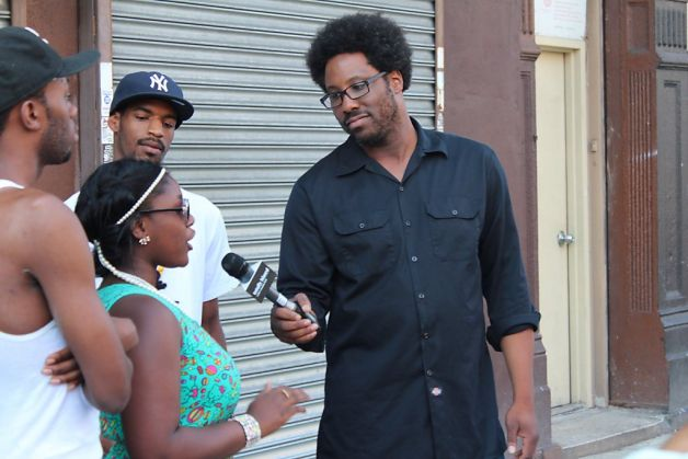 "W. Kamau Bell (right) interviews residents of Harlem about New York's ""stop and frisk"" law on the premiere of his topical weekly show on FX, ""Totally Biased With W. Kamau Bell."""