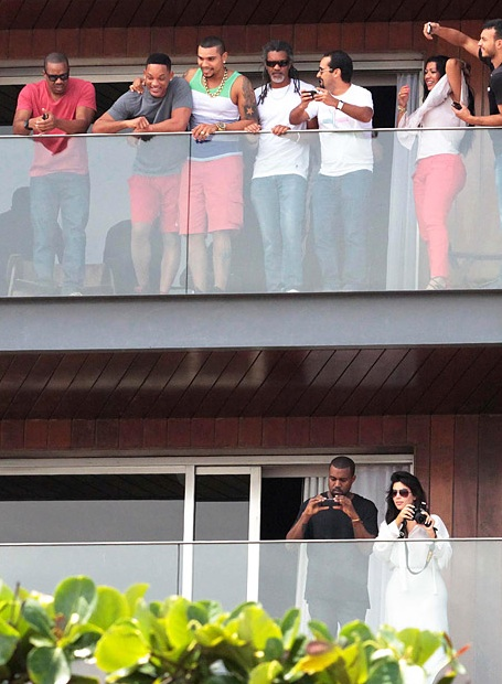 Kim Kardashian and Kanye West (below) snap photos as Will Smith parties above in Rio de Janeiro on February 11, 2013