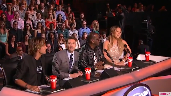Ryan Seacrest sits in Nicki Minaj's vacant seat, March 13, 2013