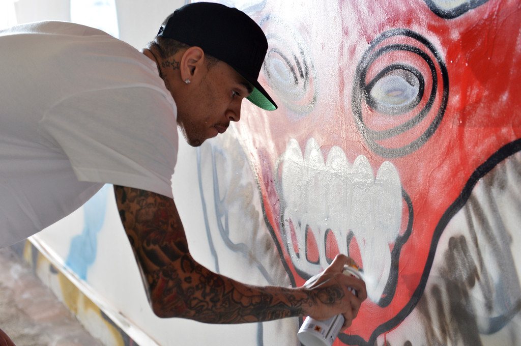 Grammy award winning artist Chris Brown joined creative forces with acclaimed graffiti artist Slick to raise funds for the Elton John AIDS Foundation and Best Buddies International March 15, 2013 in Gardena, California