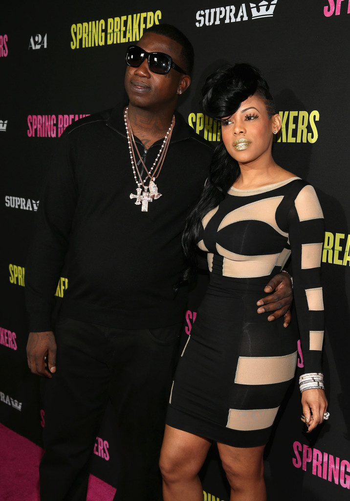 "Actor Gucci Mane (L) and guest attend the ""Spring Breakers"" premiere at ArcLight Cinemas on March 14, 2013 in Hollywood"