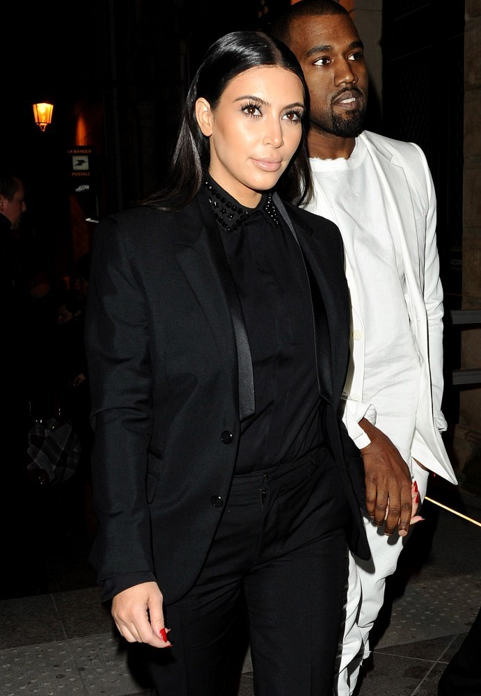 Kim Kardashian and Kanye West leaving the Givenchy Fashion Show and arriving at the Diesel Party . (March 3, 2013)
