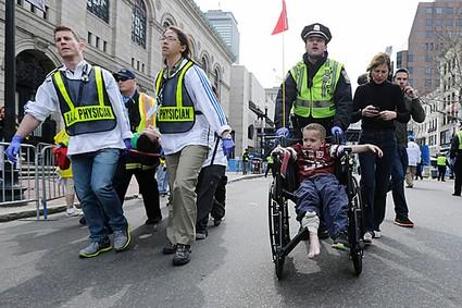 boston bombing (child in wheelchair)