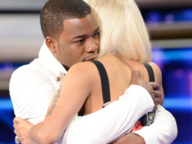 "Burnell hugs ""American Idol"" judge Nicki Minaj after the live show on April 4, 2013"