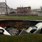 Flooding in Chicago Opens Massive Sinkhole! Swallows Three Cars! (Video)