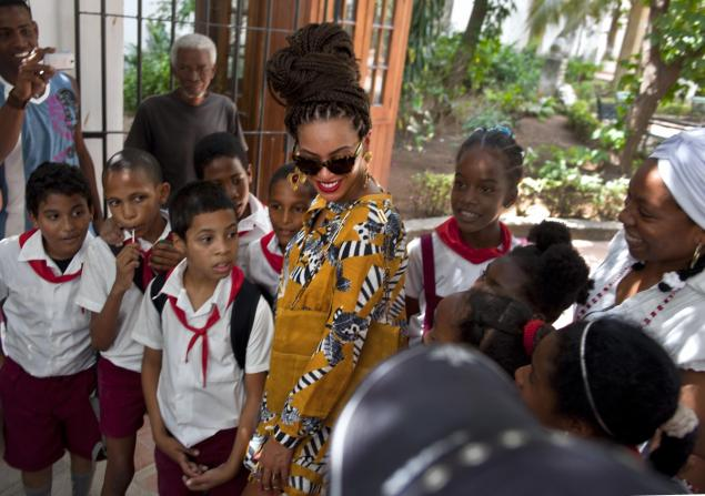 Beyonce posed for photos with school children as she toured Old Havana, Cuba, Thursday Read more: http://www.nydailynews.com/entertainment/beyonce-jay-z-celebrate-wedding-anniversary-cuba-article-1.1308081#ixzz2Pb3dIeSP